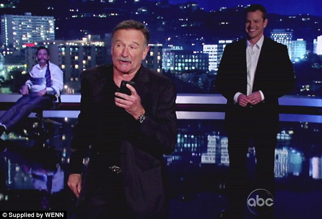 Friends in high places: Robin Williams read the autocue for Damon as Kimmel watched helplessly