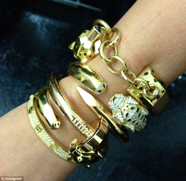 New arm swag: Kanye showered his pregnant girlfriend with thousands of dollars worth of bracelets from high-end jewelery store Cartier the day before