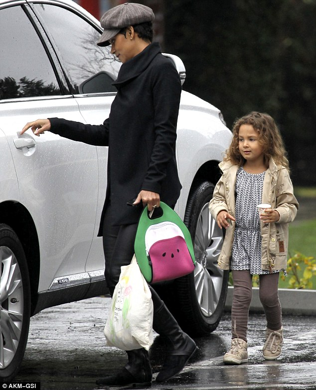 Star in a not-so-reasonably priced car: Halle got ready to open the door of her luxury vehicle for her daughter