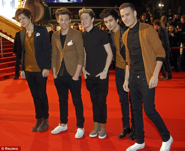 Co-ordinating: The One Direction boys wore mismatching brown and black outfits as they showed up at the event