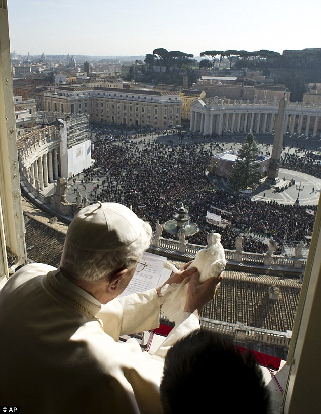 Anticipation: Pope Benedict XVI holds the dove of peace up to the sunlight moments before it is released into the air above expectant pilgrims