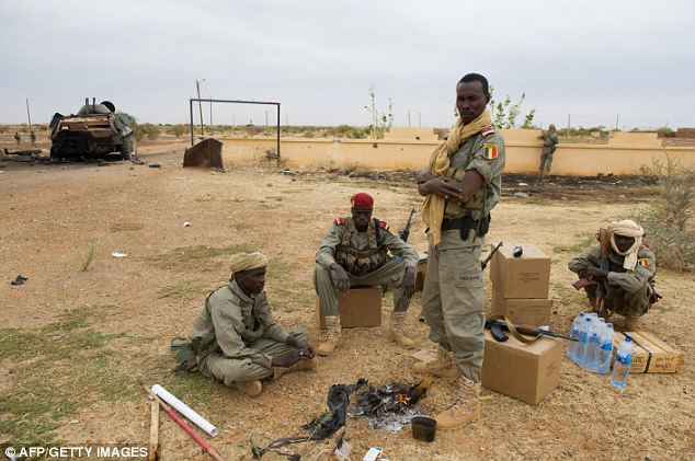 No resistance: Chad soldiers around a fire at Goa airport. The French and Malian forces so far have met little resistance from the Islamists, who seized northern Mali in the wake of a military coup in the distant capital of Bamako, in southern Mali