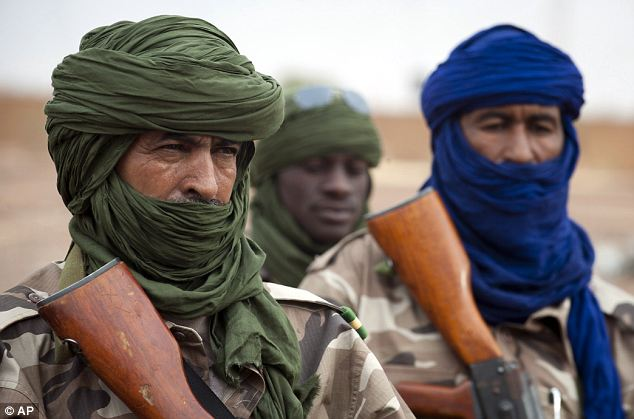 Fierce: Chadian soldiers secure Gao airport on Saturday. When they got to Timbuktu, the Islamist rebels fled, torching homes