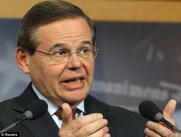 Under fire: Menendez issued a denial yesterday against allegations that he slept with prostitutes in the Dominican Republic