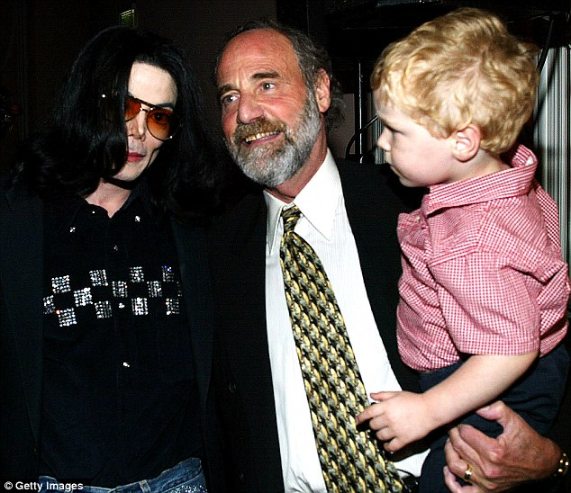 Accused: Metzger, pictured with his grandson Kailen and Jackson in 2003, says he treated the pop star for 15 years and told during the Murray trial how he refused to give the singer hospital anaethestic to help him sleep