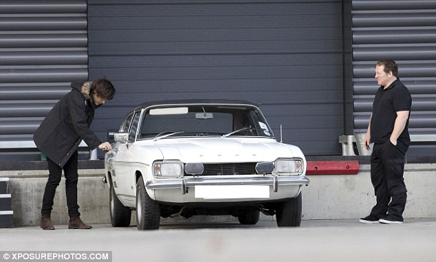 Getting used to it: He's not even had a license for two years yet but boasts a number of other cars in his possession