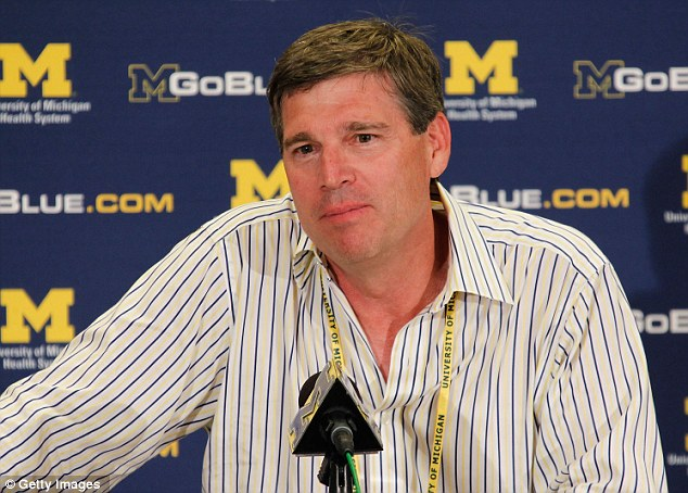 Test: Michigan athletics director David Brandon, pictured, revealed the college hired an attractive woman to contact players online