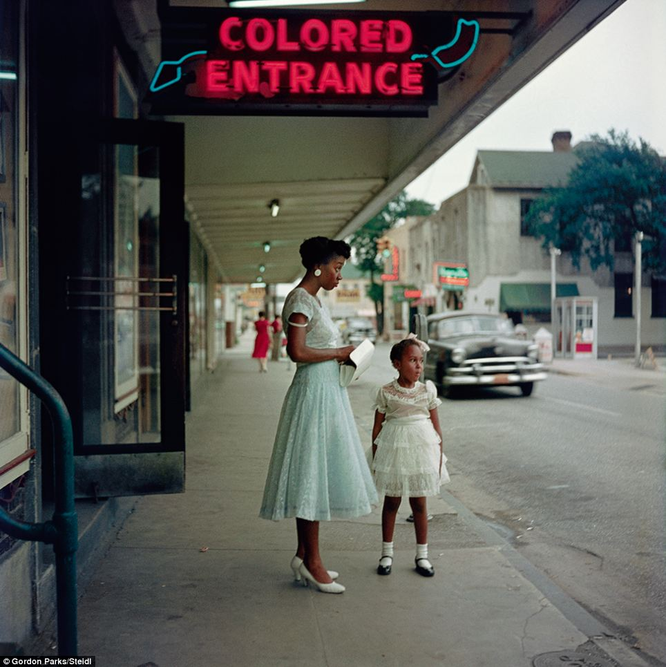 Separated: This image shows a neon sign, also in Mobile, Alabama, marking a separate entrance for African Americans encouraged by the Jim Crow laws