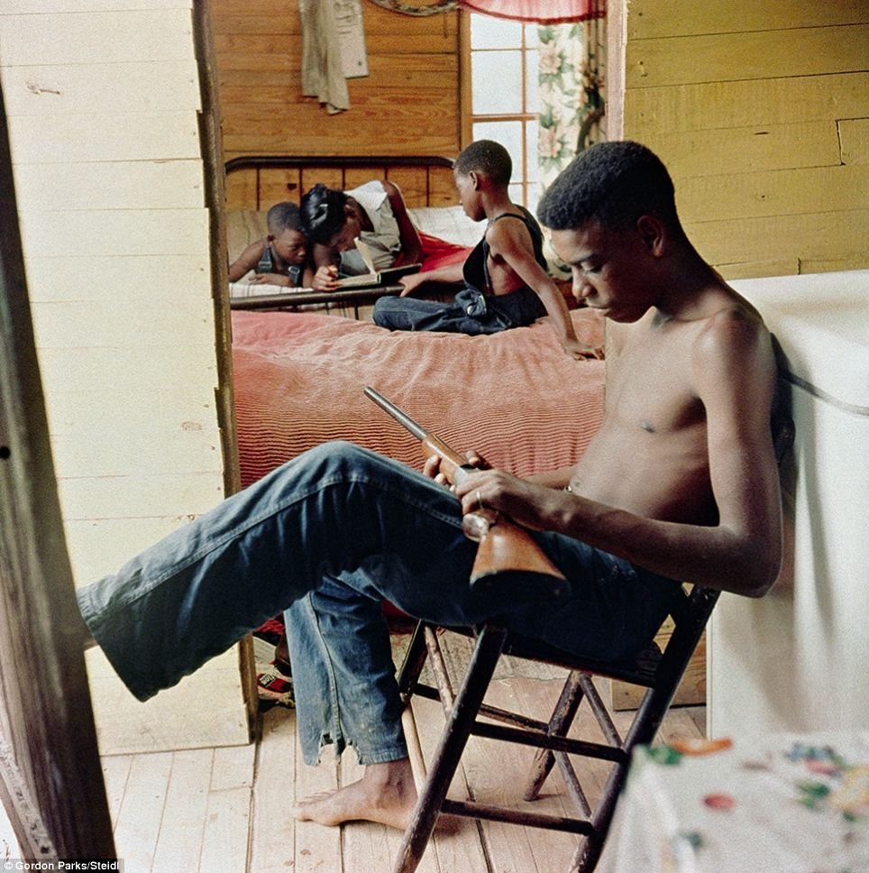 Armed: Willie Causey Junior holds a gun during a period of violence in Shady Grove, Alabama