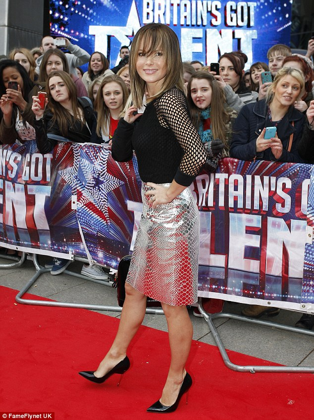 Not her usual look: The judges pairs her snakeskin skirt with a black fishnet top and black stilettos