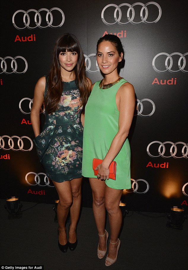 Orange bag's a winner: Olivia clutched a cute handbag while posing with fellow New Girl star Hannah Simone