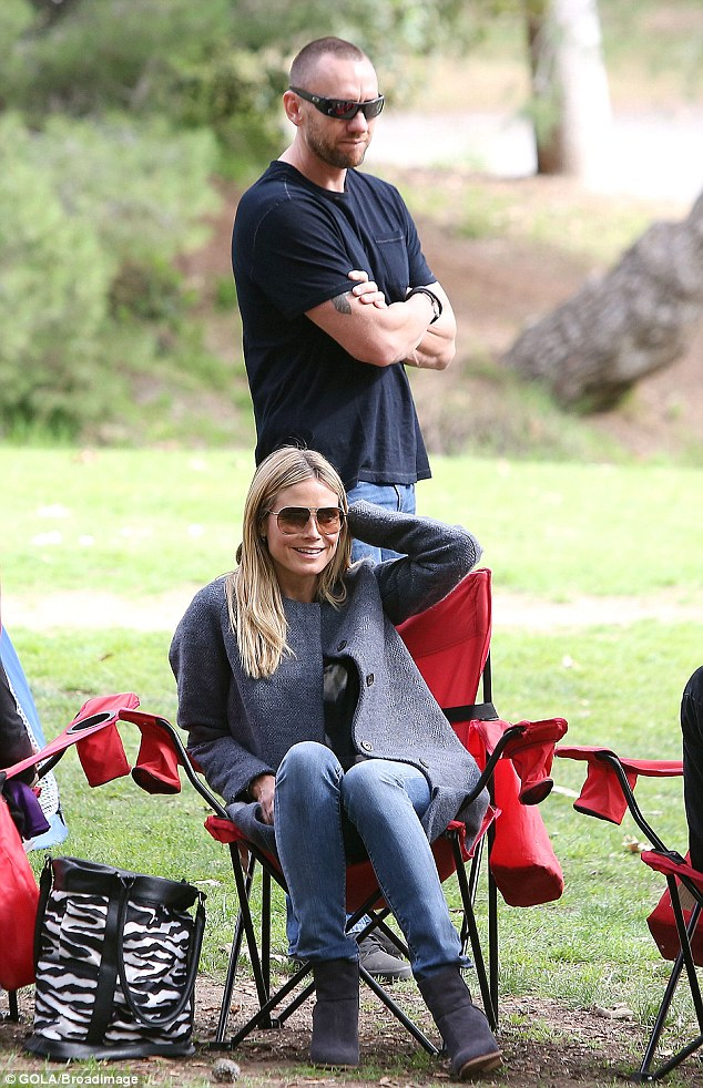 Stand by me: Heidi's handsome beau always kept a protective watch over her and the children