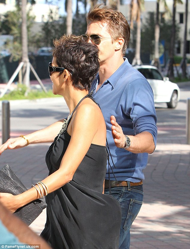 This way, dear: Olivier put a protective hand over her back