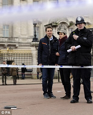 A cornered off area containing knives, a hat and Taser wire outside Buckingham Palace in central London after a man was been Tasered by police