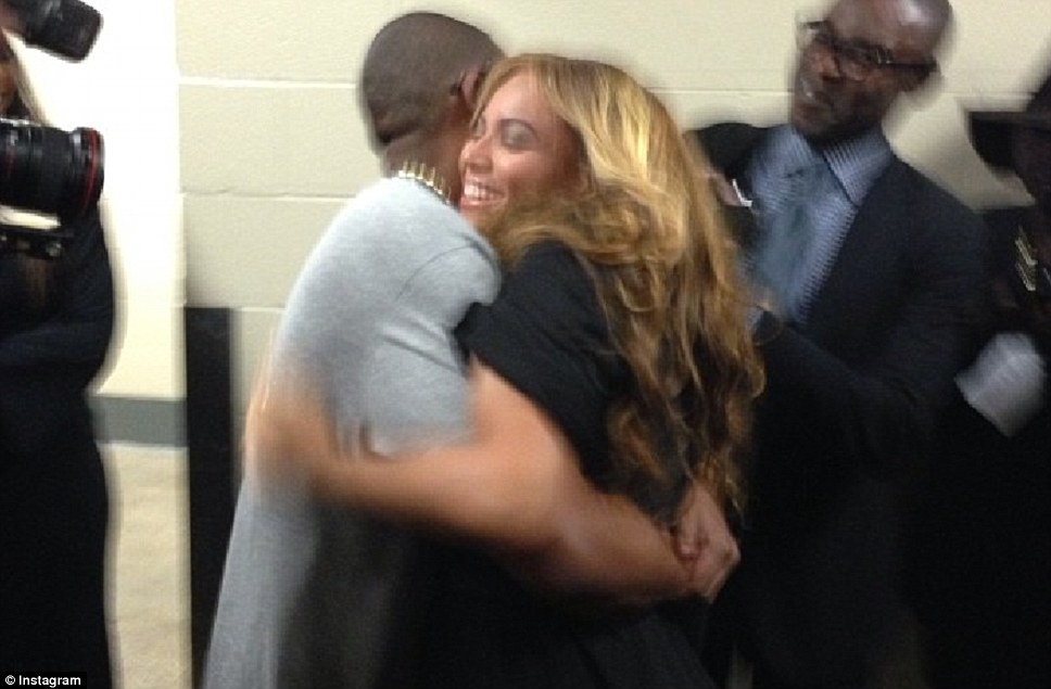 Congratulations: Beyonce is hugged by husband Jay-Z following her successful performance