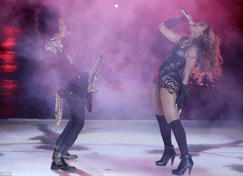 Smoking hot: The singer looked extremely focused on her performance as she sang alongside a group of female musicians