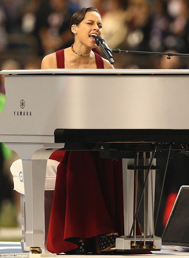 Girl on fire: Alicia Keys sang the Star Spangled Banner