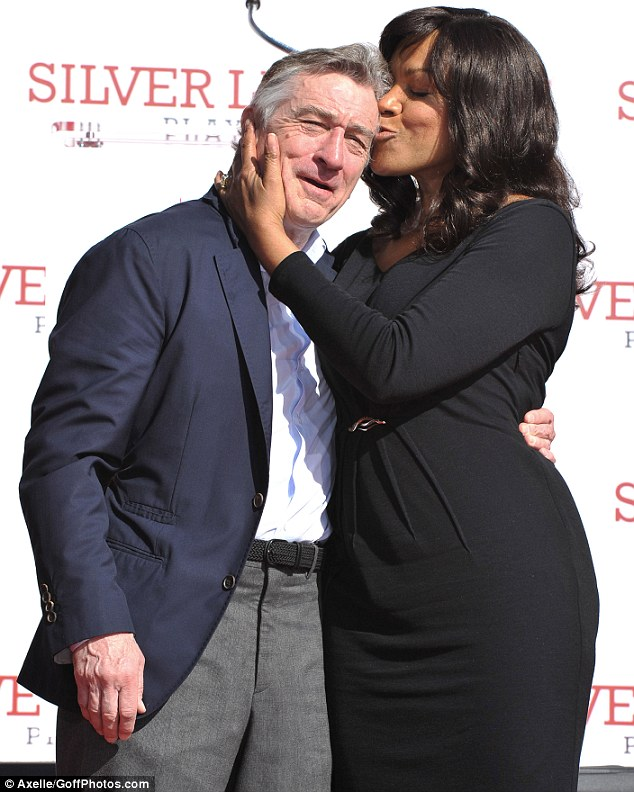Proud partner: Robert's wife Grace Hightower showed her pride by kissing her husband on the cheek at the glamorous Hollywood event