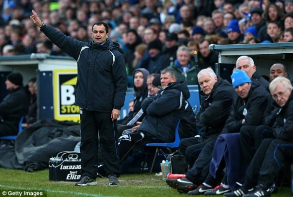 Pointing the way: Roberto Martinez has brought fluid, passing football to Swansea and Wigan