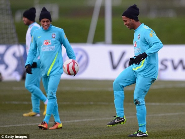 Contrasting styles: Brazil (above) and England (below) prepare for Wednesday night's friendly