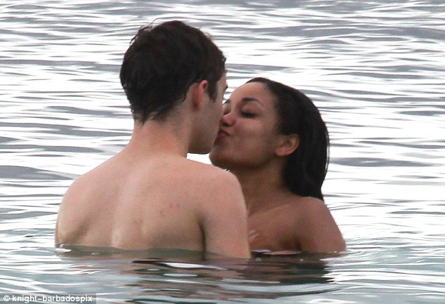 Kissing cuties: Dionne Bromfield and Nathan Sykes were seen smooching up a storm as they took a dip in the sea in St Vincent