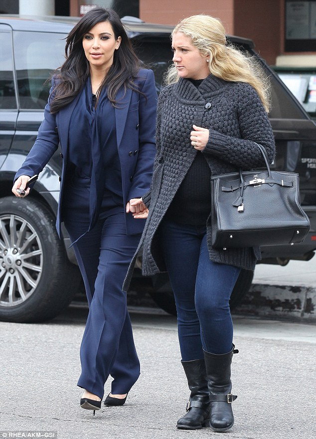Hand-in-hand: Kim and her pal were seen crossing the street hand-in-hand