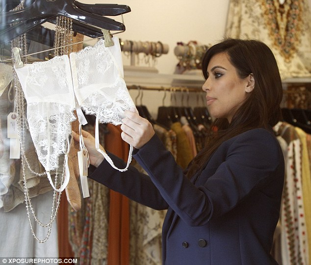 Money to burn: Kim was seen perusing the racks of clothes and lingerie inside the shop