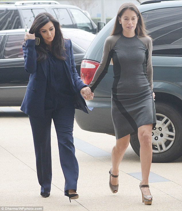 They look pretty close: Kim was seen holding hands with her divorce lawyer Laura Wasser as they headed into a meeting
