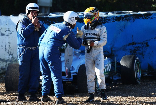Thumbs up: Hamilton emerged unscathed after the crash