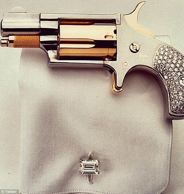 Appropriate? Kim Kardashian tweeted a picture of a jewel encrusted gun just weeks after signing the Sandy Hook pledge
