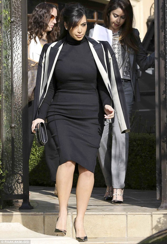 No signs of slowing down: Kim Kardashian was seen heading to a social media conference on Wednesday
