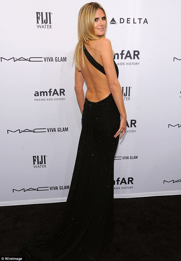 Simply stunning: Heidi Klum shows just how to wear a backless dress at the amfAR New York Gala