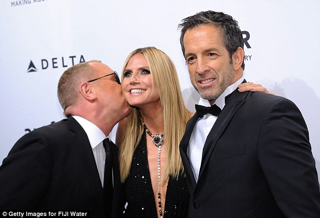 A kiss for the rose: Heidi gets a smacker from her date Michael Kors as she poses up with Kenneth Cole