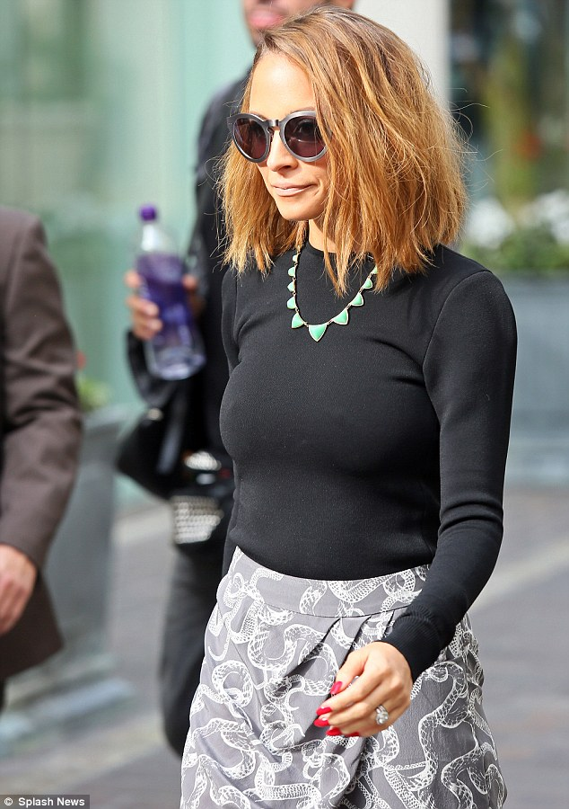 Calling the shots in the fashion game: The 31-year-old topped her look with a fitted black top