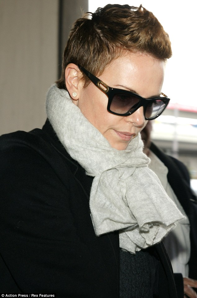 Its Getting There Charlize Theron Styles Her Hair Into
