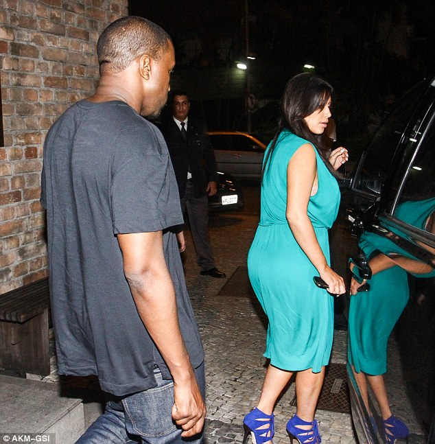 Changing shape: Kim's curves were swamped in her dress from every angle