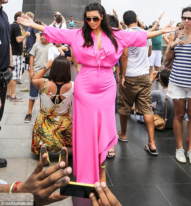 Baby on board: Kim showed off her growing baby bump