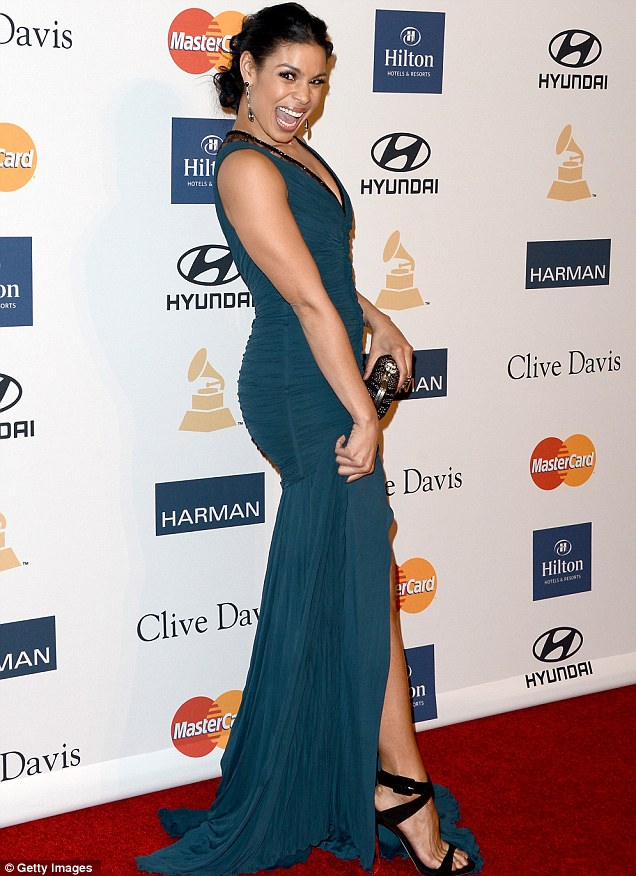 Flashing the flesh: Jordin showed off her leg in a cheeky pose on the red carpet