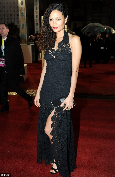 Lady in lace: Thandie Newton went for a sexier ensemble than her usual outfits in a black lace halterneck gown