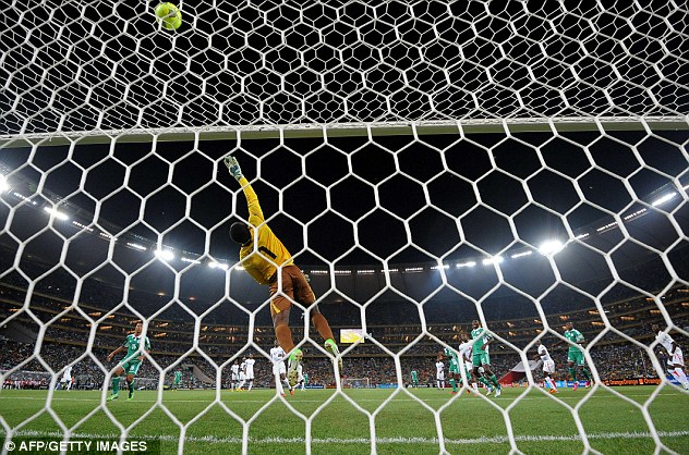 At full stretch: Burkina Faso keeper Daouda Diakite repels a Nigeria attack