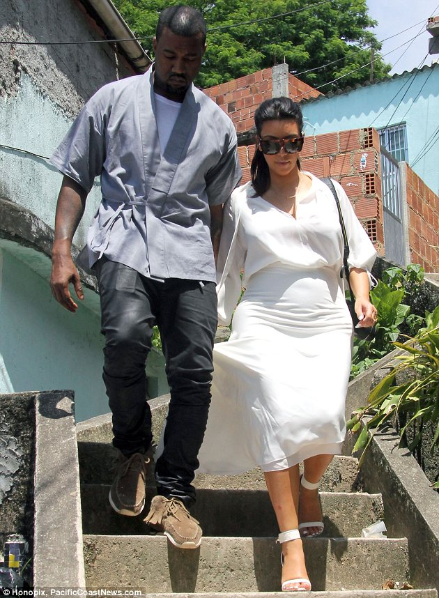 We got together: Thankfully Kim had Kanye's hand to hold onto as she navigated stairs in her high heels