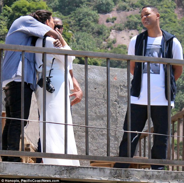 A bit awkward: Will stood politely as Kim and Kanye indulged in a PDA session during their walking tour