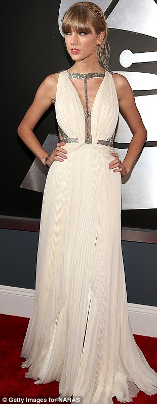 Wonderful in white: Taylor ensured she was one of the night's top fashion hits in her floaty silver and white gown