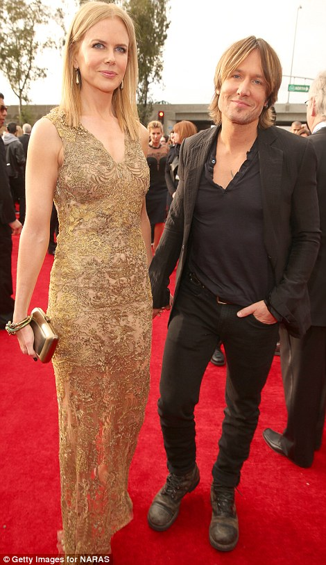 Plus one: Lopez brought along her toy boy beau Casper Smart, while Keith Urban arrived with wife Nicole Kidman
