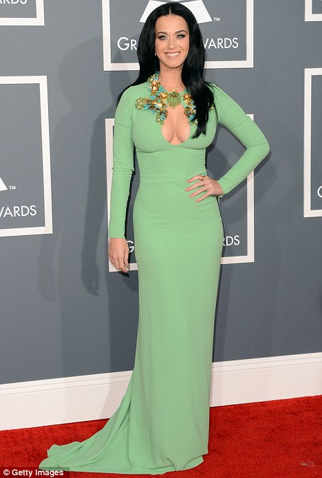 Mint green goddess: Perry told Ryan Seacrest she was inspired by Priscilla Presley's 1960s style for the red carpet