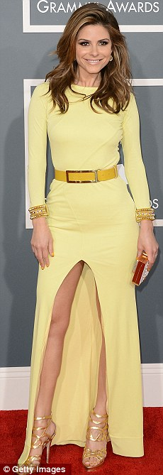 Colourful ladies: TV personality Maria Menounos is striking in lemon yellow, The B-52's Kate Pierson wore eclectic purple