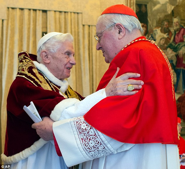 Affection: Pope Benedict XVI embraces Cardinal Angelo Sodano, Dean of the College of Cardinals, after the pontiff announced his retirement