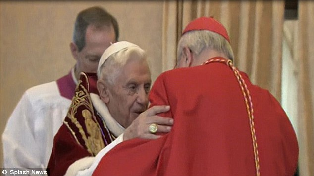 Saying his farewells: The Pontiff embraces Cardinal Angelo Sodano after the consistory