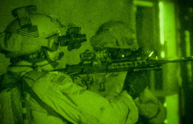 Crucial seconds: The Shooter describes the raid on bin Laden's compound in Afghanistan and how he was able to see his target through night vision goggles but that bin Laden 'could only hear but not see'