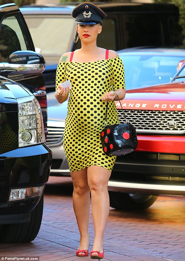Traffic-stopping: Amber stood out in her bold attire as she arrived at the department store